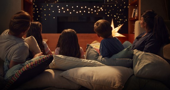 Family Enjoying Movie Night At Home Together