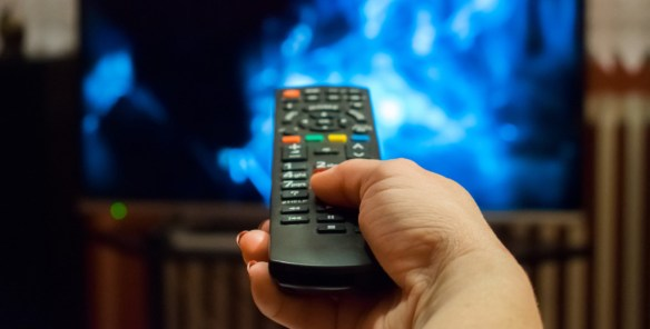 Watching tv and using remote control