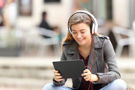 Girl on tablet listening to headphones