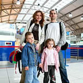 Family of four at the airport