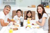10173473-family-having-breakfast-in-the-kitchen-stock-photo-eating1