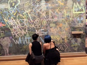 Writing chalk messages on the wall after a viewing of Basquiat's work at the AGO, photo by Cherryl Bird