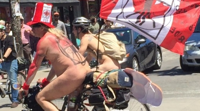 Naked bike ride through downtown Toronto