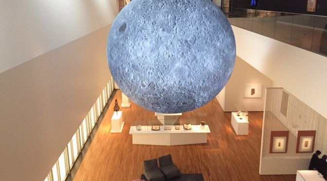 A giant replica of the Moon hangs from the second-floor ceiling