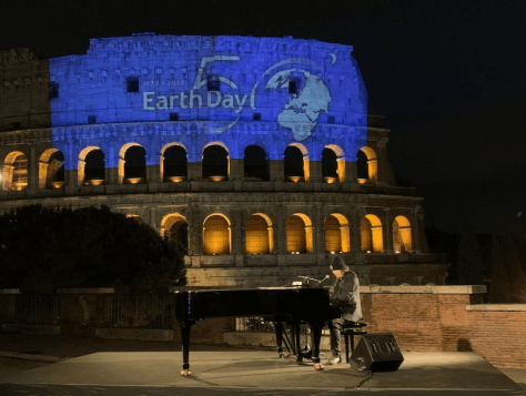 Zucchero and Bono singing 'Canta La Vita' in front of Rome's Colosseum