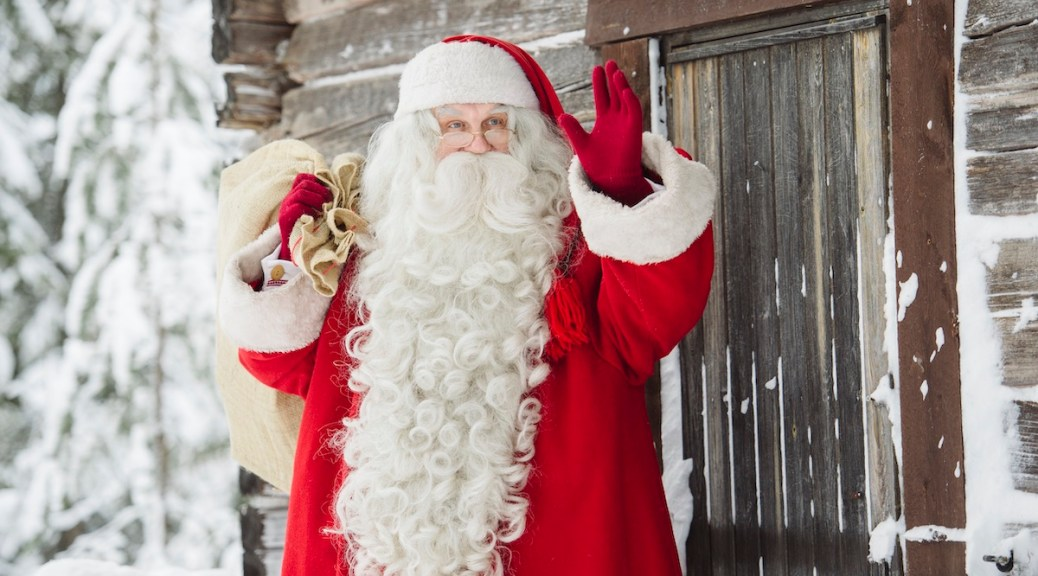 A bearded, suited Santa Claus in Rovaniemi