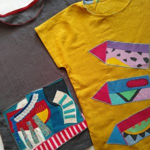 Linen tops with appliqué made from recycled fabric