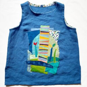 Linen tank top with appliqué made from recycled fabric