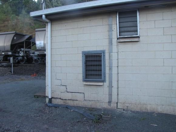 Photo of cracked concrete masonry building