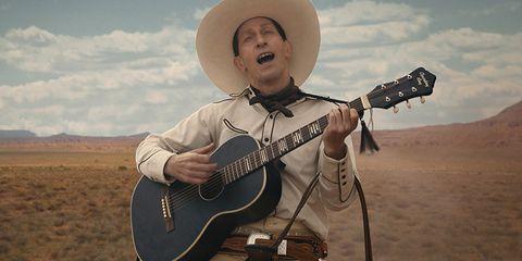 Buster Scruggs met gitaar