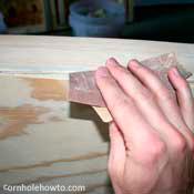 Sanding the edges.