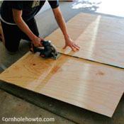 Cutting plywood with a circular saw.
