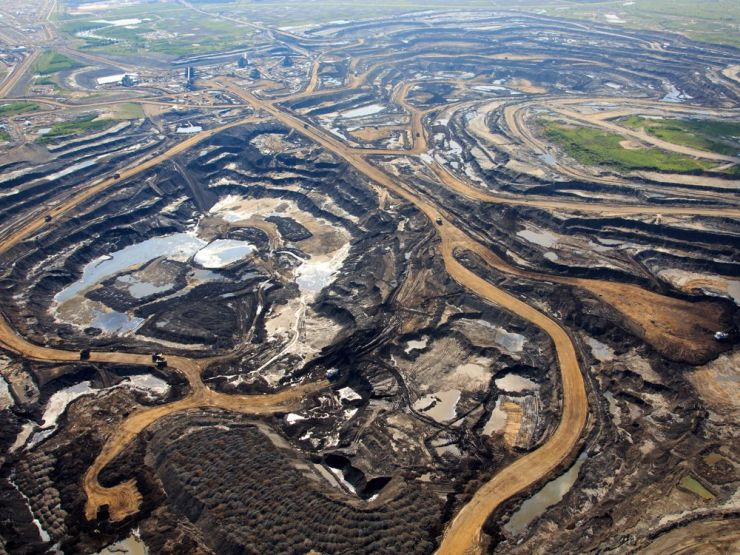 An aerial view of Canadian Natural Resources Ltd. (CNRL) oilsands mining operation near Fort McKay, Alta. on June 18, 2013.