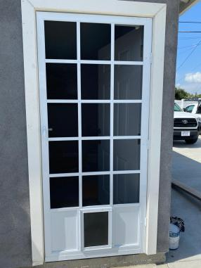 White Cap Cod with small pet door installed.