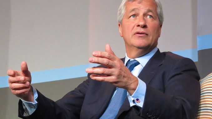Jamie Dimon, head of JP Morgan, has criticised US tax policy for failing to growth jobs and wages.