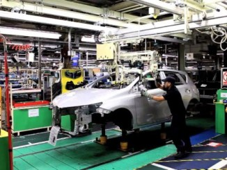 A car is assembled at the Toyota plant in Burnaston, England.