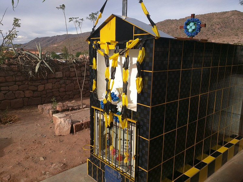 Tomb decorated in soccer team colors for Day of the Dead in Bolivia