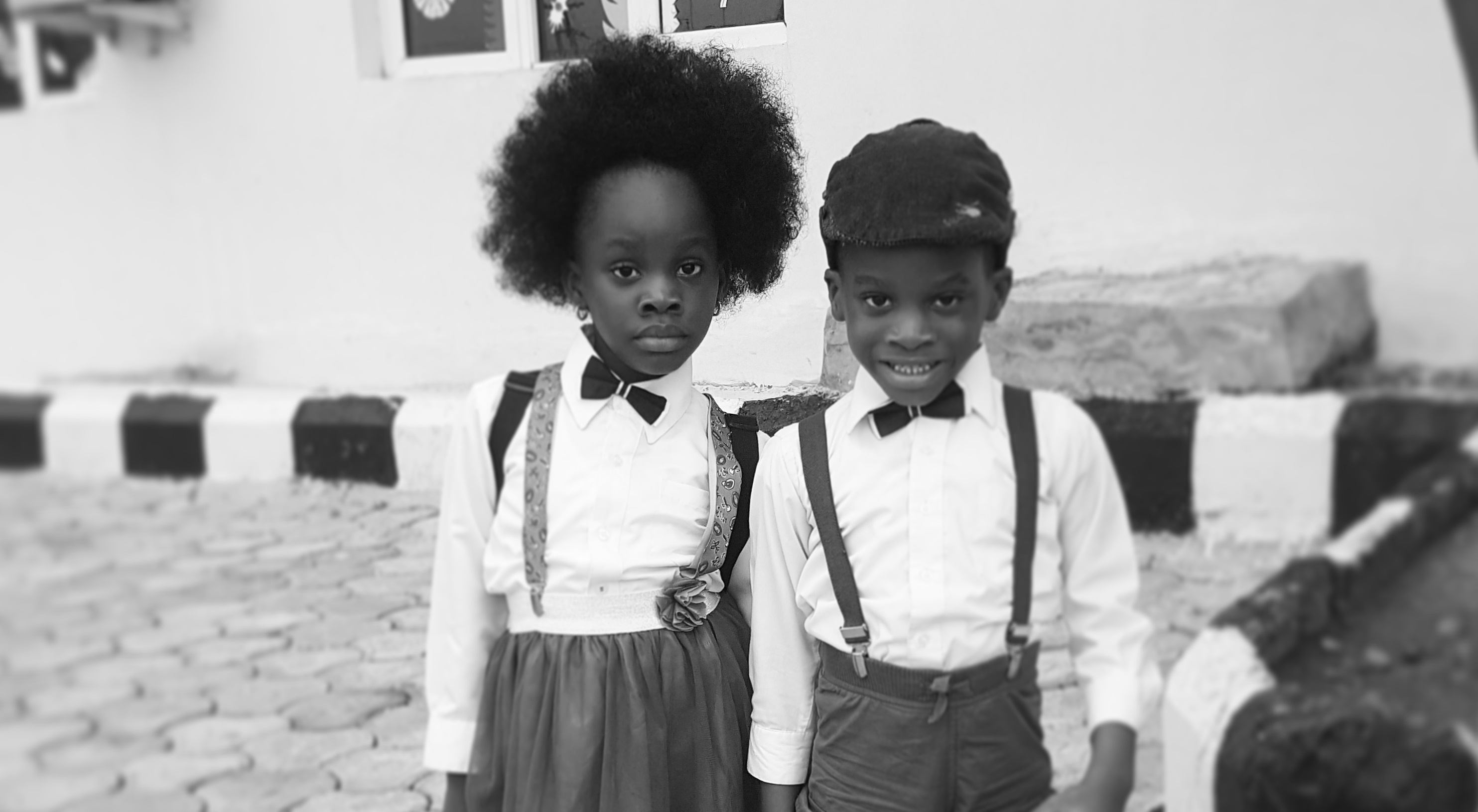 Beautiful pictures of a twin in their old school outfit