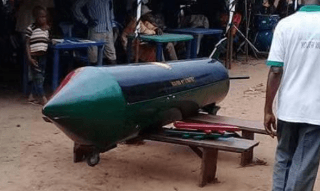 IPOB member buried in a rocket-like casket with Biafran colour