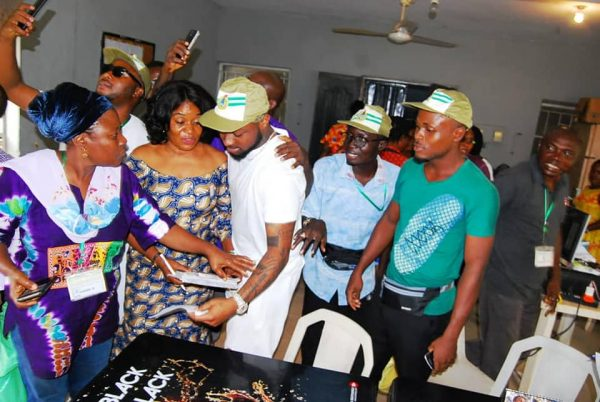 Officials gather for selfies as Davido registers for
