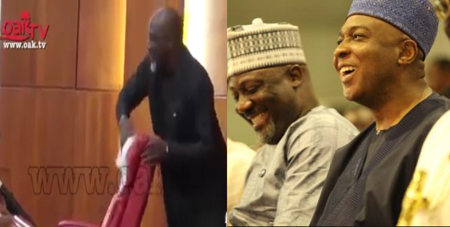 Drama as Senator Dino Melaye uses handkerchief to clean 'Juju' from Saraki's seat (Video)