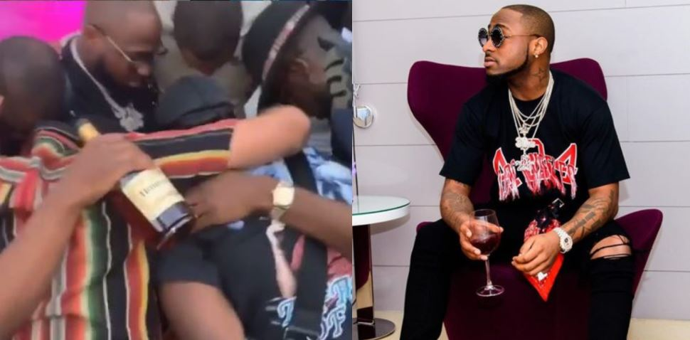 Davido praying with his crew members before a show with one of them holding a bottle of Hennessy, Nigerians react