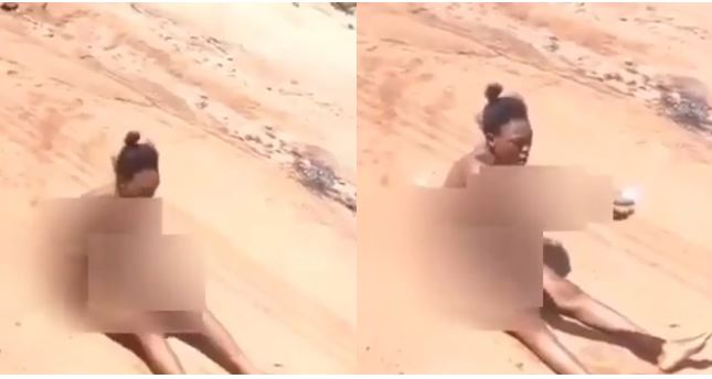 Ghanaian Lady strips naked, drags her butt through the street to curse her boyfriend who dumped her (video)