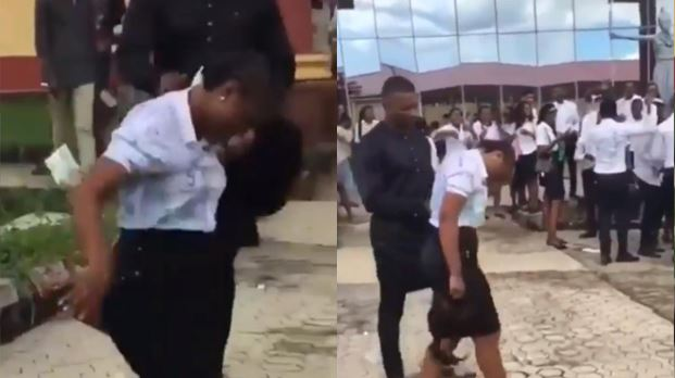 Man sprays bae money in front of exam hall after her final exams (Video)