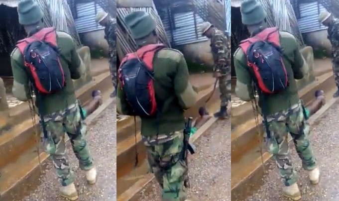Soldiers force man to strip and swim in gutter as punishment for flouting stay-at-home order (Video)