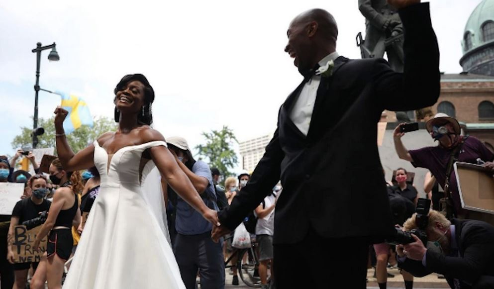 Philadelphia couple joins protest immediately after their wedding, making it a wedding reception