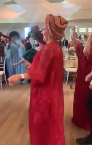 Oyinbo men and women cause stir at wedding as they rock Igbo native attire and display 'funny' dance steps to Flavour's song (Video)
