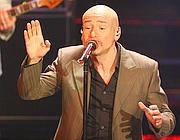 Mario Venuti: nel cd canta «Meriggiare pallido e assorto»  (foto Ansa)