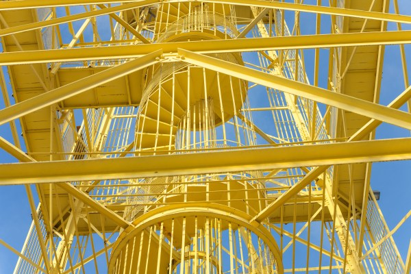 Industrial construction - Yellow metal structure with vivid blue sky background