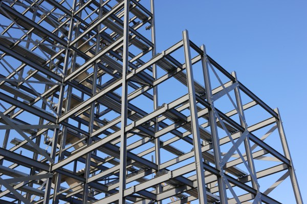 Construction steel framework against blue sky.