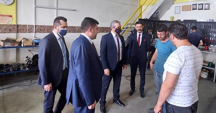 MHP'den esnafa moral ziyareti