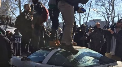 Police are asking for the public's help identifying suspects captured on video jumping on top of a woman's car at the Eagles Super Bowl parade.