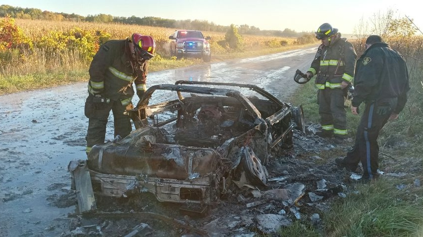 Firefighters put out a fire in a Corvette in Clearview Township, Ont. on Sunday October 11, 2020 (Trevis Fenwick)