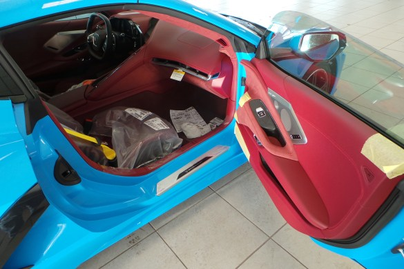 2021 Corvette in Rapid Blue with Morello Red Dipped Interior and Yellow Seat Belts