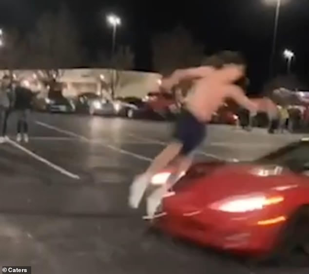 A teenage daredevil in St. Louis, Missouri flips over a C6 Corvette driving straight towards him at 30mph in terrifying stunt.