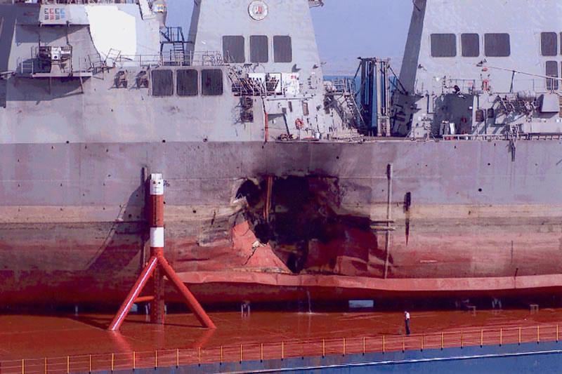 USS Cole after the terrorist attack in Yemen   Photo: FBI