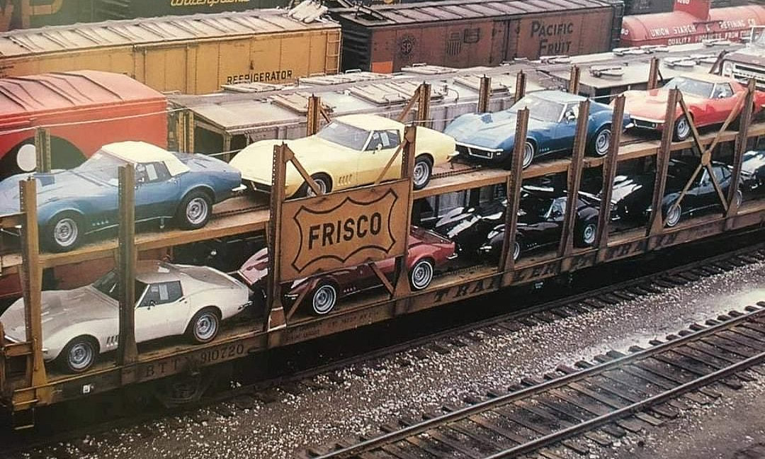 Vintage photo of a rail car filled with 1968 Corvettes