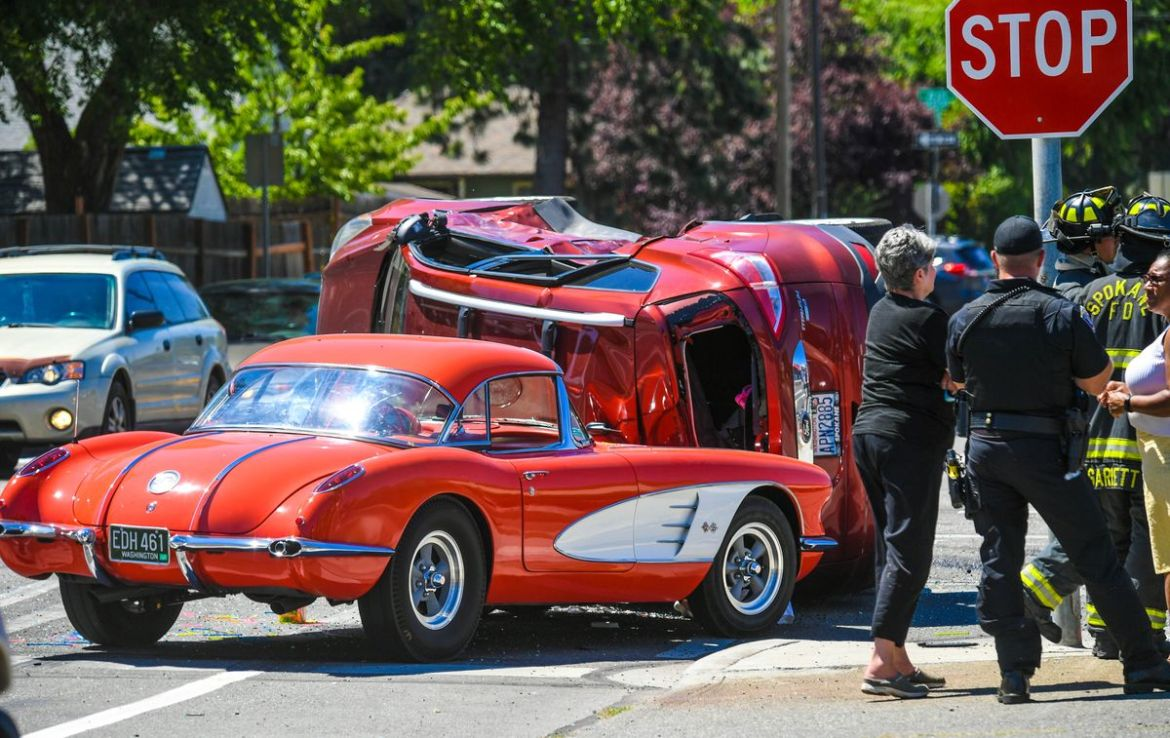 Gary Keyes takes a look at the damage to his restored 1958 Chevy Corvette after a 2014 Ford Escape slid into the classic car Thursday on the corner of Maple Street and Rowan Avenue in Spokane. Keyes had planned to visit a car show in Oregon in two weeks. (DAN PELLE/THE SPOKESMAN-REVIEW)