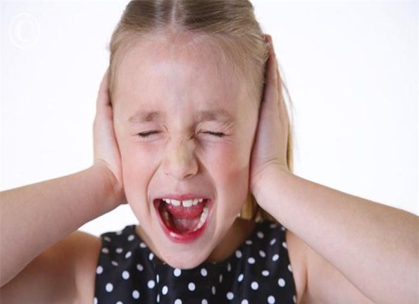 Girl with Hands over Ears Screaming