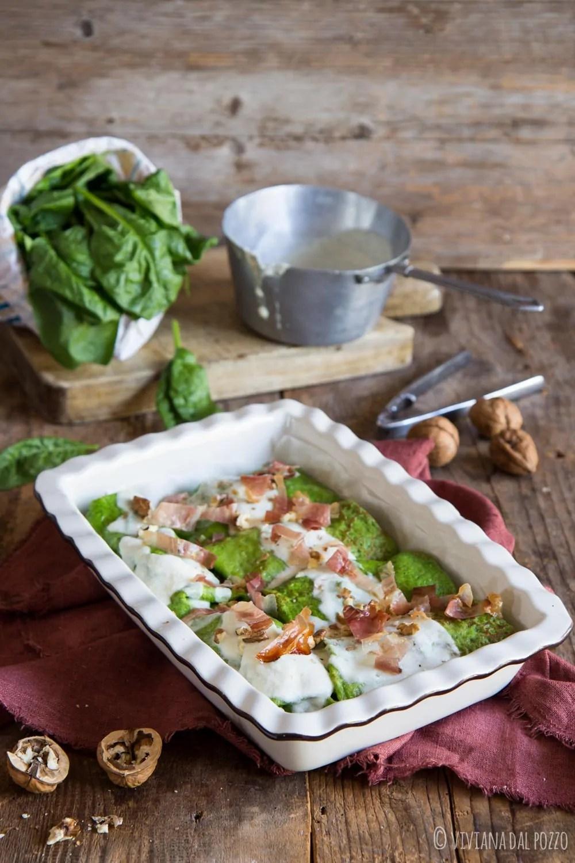 Crespelle verdi agli spinaci con crema di zucca filante, speck e noci