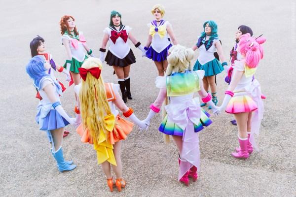 Cosmic Coterie posing in their Super Sailor Senshi cosplays.