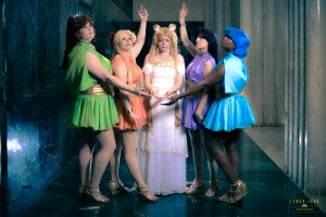 Cosmic Coterie posing in their Silver Millennium Senshi costumes.