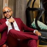 Banky W sitting on a chair