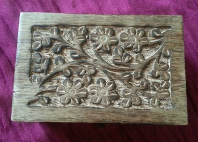 wooden storage box with flower motif detail