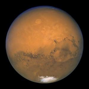 En el año 2003, Marte hizo su máximo acercamiento a la Tierra, a tan sólo unos 55.757.930 km de distancia. El Telescopio Espacial Hubble aprovechó esta oportunidad para observar el planeta rojo. Crédito: NASA, J.Bell (Cornell U.) y M. Wolff (SSI).