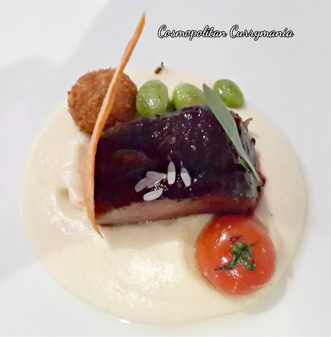 Beetroot-glazed lamb loin, Pulled lamb croquette, Parsnip puree and Reconstructed carrot-potato.